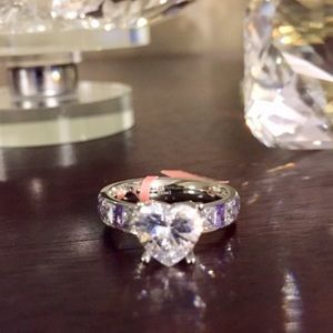 Ring: Purple and white CZ stainless steel ring.